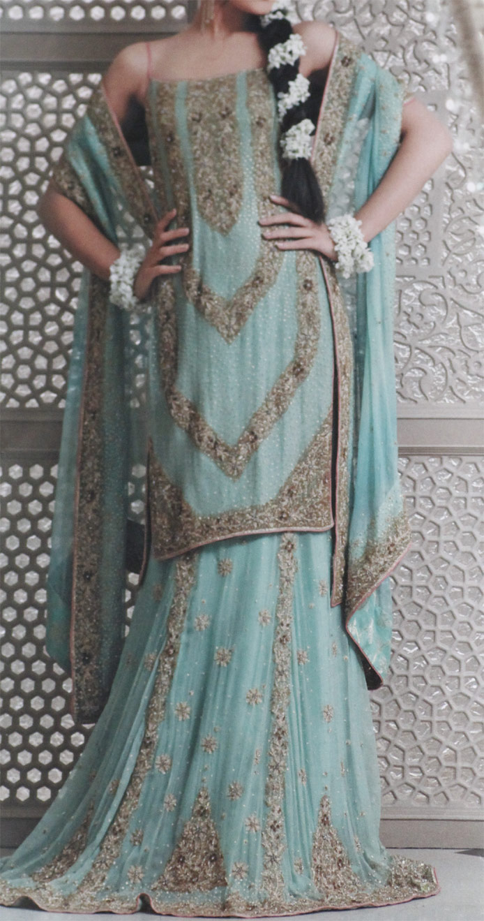 Turquoise Colour Lengha in a light greenish blue ting